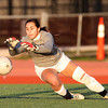 Beverly: Beverly junior goalie Kyra Wolonsavich makes a diving save against Peabody on Friday afternoon. David Le/Salem News