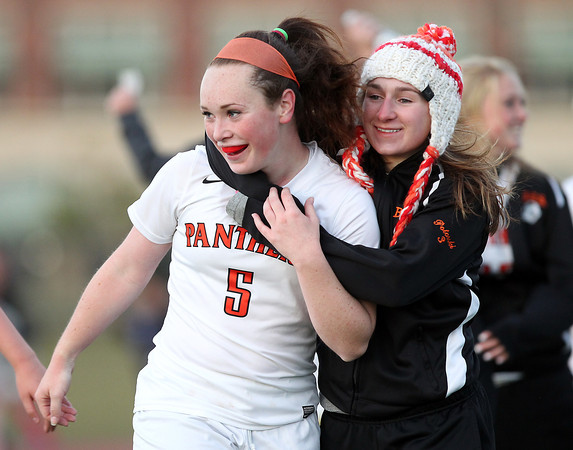 Beverly: Beverly sophomore Sarah Visnick gets a hug from a teammate after the Panthers defeated Peabody 3-2 to earn a split of the NEC Large Title. David Le/Salem News