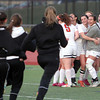 Beverly: The Beverly girls soccer team runs out onto the field to mob junior goalie Kyra Wolonsavich, after the Panthers defeated Peabody 3-2 to earn a share of the NEC large title with the Tanners. David Le/Salem News
