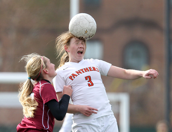 Lynn: Beverly senior captain Casey Cook (3) wins a header against Concord-Carlisle on Saturday morning. David Le/Salem News