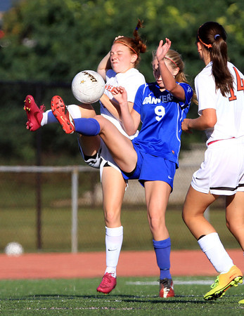 Beverly: Beverly junior Rose Terner (21), and Danvers sophomore Olivia Davis (9) both fight for the ball during the second half of play on Tuesday afternoon. David Le/Salem News