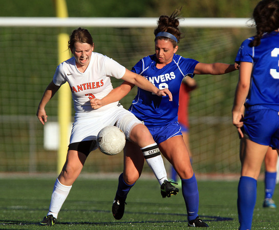 Beverly: Beverly senior captain Casey Cook (3) tries to shield the ball from Danvers senior midfielder Courtney Arnoldy (18) during the second half of play on Tuesday afternoon. David Le/Salem News