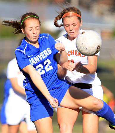 Beverly: Danvers junior Becca Horn (22) and Beverly junior Maddie Curran (8), collide as they battle for a loose ball on Tuesday afternoon. David Le/Salem News