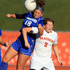 Beverly: Danvers senior midfielder Courtney Arnoldy (18) and Beverly senior captain Casey Cook (3) battle for a 50/50 header on Tuesday afternoon. David Le/Salem News