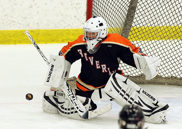Salem: Beverly goalie Madison Jalbert (25) makes a stick save against HPNA at Rockett Arena at Salem State University on Wednesday evening. DAVID LE/Staff Photo