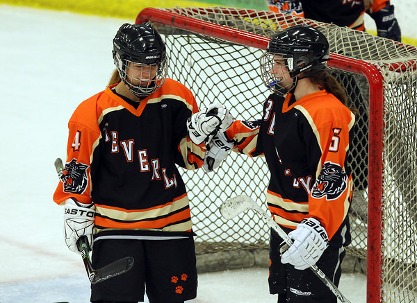 Salem: Beverly senior Nicole Woods (4) greets forward Kristen McCarthy (5) after she scored her second goal of the game to give the Panthers 3-0 in at the end of the second period at Rockett Arena at Salem State University on Wednesday evening. DAVID LE/Staff Photo
