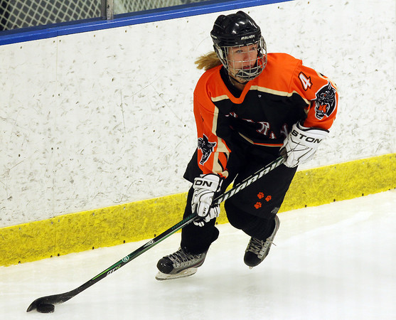 Salem: Beverly senior center Nicole Woods carries the puck behind the net against HPNA at Rockett Arena at Salem State University on Wednesday evening. DAVID LE/Staff Photo