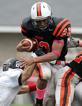 Beverly: Beverly senior running back Isiah White bursts through the Marblehead defense for a big gain on Saturday afternoon. David Le/Salem News