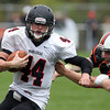 Beverly: Marblehead junior running back Brooks Tyrrell (44) tries to turn the corner while being held onto by Beverly senior captain Zach Duguid (50) on Saturday afternoon. David Le/Salem News