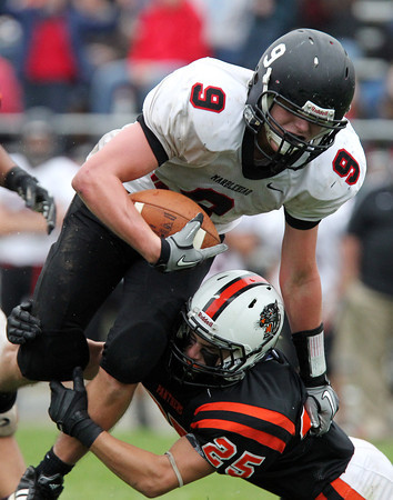 Beverly: Beverly senior captain Joey Kozlowski (25) wraps up Marblehead junior Will Millett (9) at the ankles and takes him down on Saturday afternoon. Kozlowski and the Panthers upset the previously unbeaten Magicians 17-14 at Hurd Stadium. David Le/Salem News