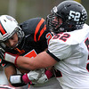 Beverly: Marblehead senior Liam Gillis (52) brings down Beverly senior Bruno Caetano (27) after a reception on Saturday afternoon. David Le/Salem News