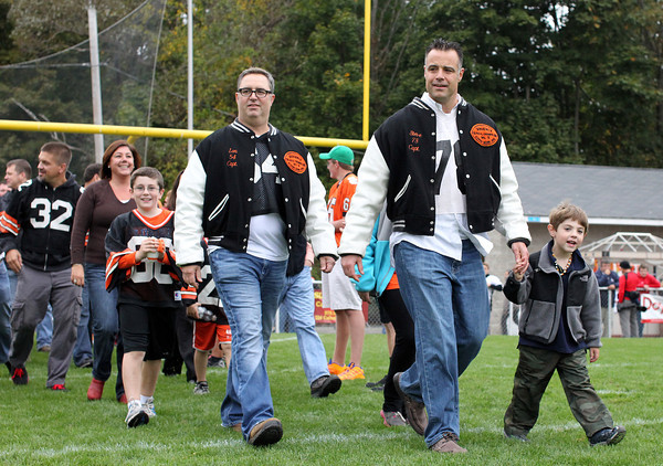 Beverly: The 1988 Beverly Panther undefeated Super Bowl team was honored at halftime of the Beverly-Marblehead game on Saturday afternoon. Two of the captains of the '88 team Lon Hamor, left, and Steve Costa, right, led the Panthers onto the field on Saturday. David Le/Salem News