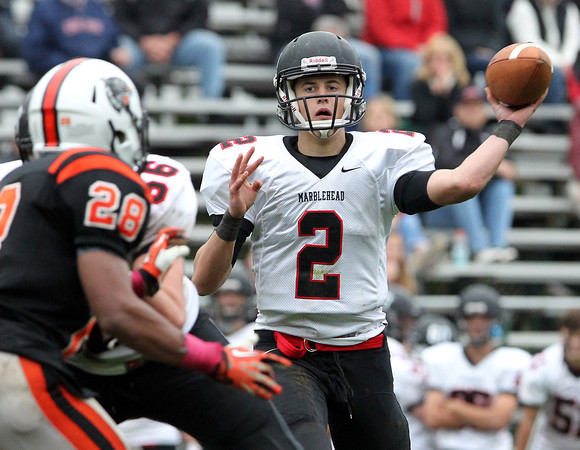 Beverly: Marblehead senior quarterback Matt Millett fires a pass against Beverly on Saturday afternoon. David Le/Salem News