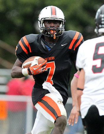 Beverly: Beverly sophomore running back Peter Mulumba (7) looks for running room against Marblehead on Saturday afternoon. David Le/Salem News