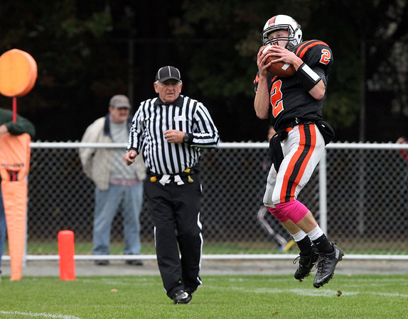 Beverly: Beverly senior quarterback Nick Manthorne catches a pass from senior teammate Joey Kozlowski (25) on a reverse half-back pass on 4th down against Marblehead. David Le/Salem News
