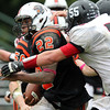 Beverly: Beverly senior running back Isiah White (22) bursts through the Marblehead defense and surges upfield for a big gain on Saturday afternoon. David Le/Salem News