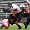 Beverly: Marblehead senior quarterback Matt Millett (2) gets sacked by Beverly sophomore Matt Madden (28) and senior captain Sean Winston (53) on Saturday afternoon. David Le/Salem News