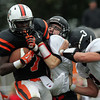 Beverly: Beverly sophomore running back Peter Mulumba (7) plows forward while being brought down by Marblehead senior Trey Blackmer (21) and junior Spencer Craig (3) on Saturday afternoon. David Le/Salem News