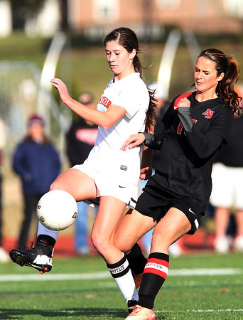 Beverly: Beverly senior captain Caitlin Harty controls the ball while being pressured by North Andover senior captain Tori Sullivan (15) during the second half of play on Sunday afternoon. David Le/Salem News