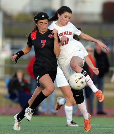 Beverly: Beverly senior captain Kristen O'Connor (10) leaps in the air and boots the ball upfield, away from North Andover's Michaela Guthrie (7) during the second half of play on Sunday afternoon. David Le/Salem News