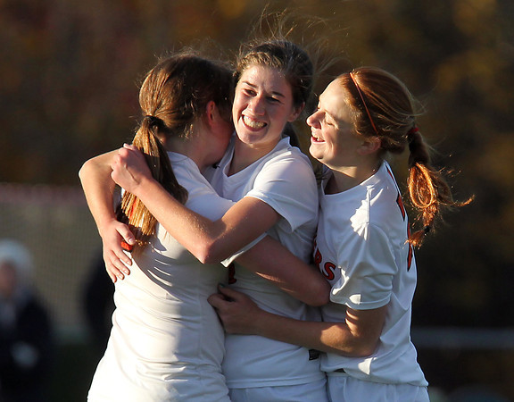 Beverly: Beverly High School senior striker Caitlin Harty, center, gets hugged by teammates Casey Cook, left, and Rose Terner after Harty notched her third goal of the game against North Andover in the first round of the D2 North Tournament. David Le/Salem News