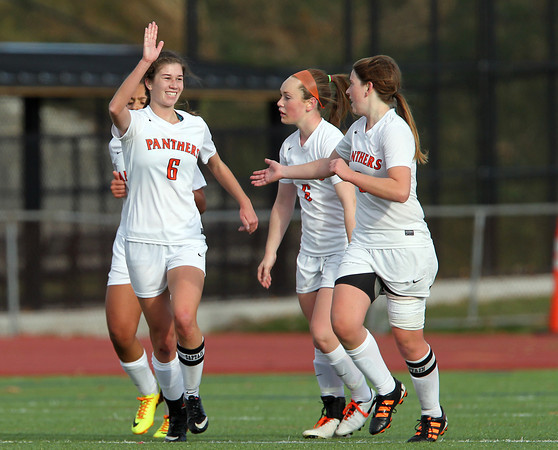Beverly: Beverly senior captain Caitlin Harty (6) gives fellow senior captain Casey Cook (3) a high five after Cook wove through the North Andover defense and delivered a cross to Harty for the Panthers' second goal of the game. David Le/Salem News