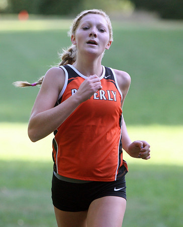 Beverly: Beverly junior Julianna Wesley sprints across the finish line to capture 4th place overall for the Panthers against Peabody. Wesley (19:20), freshman Abby Walsh (18:50), and senior captain Nicole Demars (19:01) took three out of the top four spots to lead the Panthers to a 22-37 victory over the Tanners. David Le/Salem News