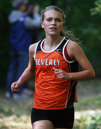Beverly: Beverly junior Maeve Monahan runs down a hill and around a corner at JC Phillips Park during the Panthers meet against Peabody on Wednesday afternoon. David Le/Salem News