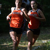 Beverly: Beverly freshman Abby Walsh, left, and senior captain Nicole Demars run together at the front of the pack against Peabody for the NEC Championship on Wednesday afternoon. Walsh finished first (18:50) and Demars second (19:01) to help Beverly to a 22-37 win over the Tanners. David Le/Salem News