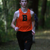 Beverly: Beverly junior Zach Bauer runs through the woods at JC Phillips Park during Wednesday afternoon's NEC cross country meet against Peabody. David Le/Salem News