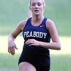 Beverly: Peabody junior Lauren Barrett sprints towards the finish line against Beverly on Wednesday afternoon. Barrett took third (19:16) overall but it wasn't enough as Beverly edged out the Tanners 22-37 to capture the NEC Championship. David Le/Salem News