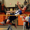 Beverly: Peabody junior Mike Raymond leaps high in the air while clearing the high jump bar against Beverly on Thursday afternoon. DAVID LE/Staff Photo