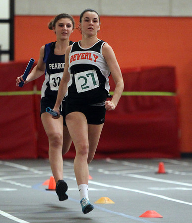 Beverly: Beverly senior captain Kristen O'Connor, right, sprints ahead of Peabody freshman Dana Vidala, as the Panthers won the 4x400 meter relay and their NEC meet against rival Tanners. DAVID LE/Staff Photo