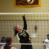 Peabody: Bishop Fenwick junior Alexis Bedard (12) leaps high in the air and smashes the ball over the net against St. Mary's on Tuesday afternoon. David Le/Salem News
