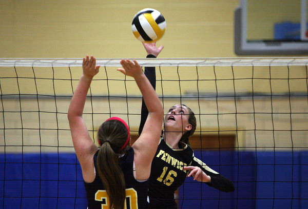 Peabody: Bishop Fenwick sophomore Melissa MacKenzie (16) leaps high in the air and spikes the ball past the outstretched arms of a St. Mary's player on Tuesday afternoon. David Le/Salem News