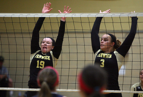 Peabody: Bishop Fenwick senior captain Tessa McLaughlin (19) and junior Madison Camelo (3) leap high in the air to block a shot against St. Mary's on Tuesday afternoon. David Le/Salem News