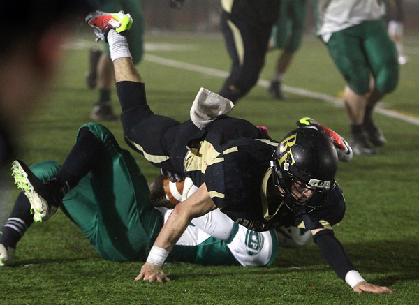 Woburn: Bishop Fenwick senior linebacker Nick Bona (5) levels Abington junior quarterback Bryan Dwyer during the 4th quarter of play in the D5 State Semifinal at Connolly Stadium in Woburn on Friday evening. David Le/Salem News
