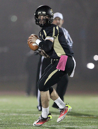 Woburn: Bishop Fenwick senior quarterback Nick Bona (5) drops back to pass in the D5 State Semifinal at Connolly Stadium in Woburn on Friday evening. David Le/Salem News