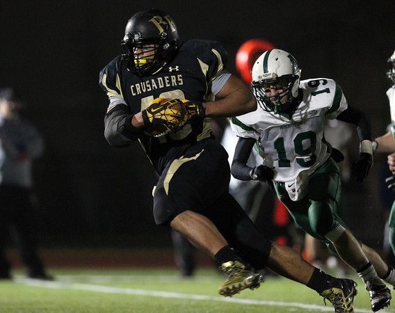 Woburn: Bishop Fenwick junior running back Rufus Rushins (49) breaks away from the Abington defense and into the open field on his long first half touchdown run in the D5 State Semifinal at Connolly Stadium in Woburn on Friday evening. David Le/Salem News