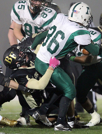 Woburn: Bishop Fenwick senior linebacker James Traversey brings down Abington running back Shawn Donovan (36) for a loss of yards during the D5 State Semifinal at Connolly Stadium in Woburn on Friday evening. David Le/Salem News