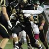 Peabody: Bishop Fenwick senior kick returner Eric Razney (13) bursts through multiple tackles from Austin Prep defenders and returns the second half kickoff for a 78-yard touchdown. David Le/Salem News