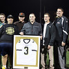 Peabody: Former Bishop Fenwick star running back Bobby Tarr (3) surrounded by his teammates during a halftime presentation where his number 3 jersey was retired. David Le/Salem News
