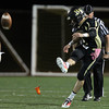 Peabody: Bishop Fenwick senior Nick Bona boots a kickoff against Austin Prep on Friday evening. David Le/Salem News