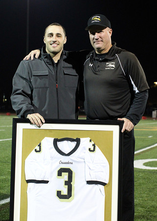 Peabody: Bishop Fenwick football head coach Dave Woods and former Crusaders running back Bobby Tarr during a halftime presentation where Tarr's number 3 was retired by Bishop Fenwick. David Le/Salem News