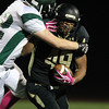 Peabody: Bishop Fenwick junior running back Rufus Rushins (49) carries an Austin Prep defender for a few more yards as he powers his way towards the end zone on Friday evening. David Le/Salem News