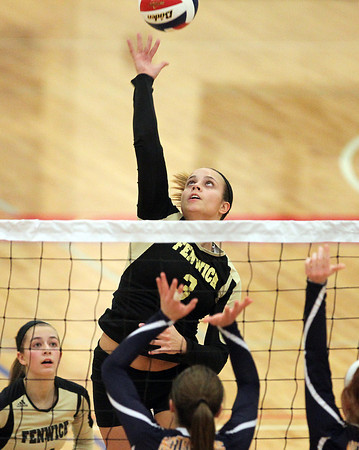 Tewksbury: Bishop Fenwick junior Madison Camelo (3) leaps high in the air and bats the ball over the net against Notre Dame Academy on Wednesday evening. David Le/Salem News