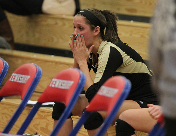 Tewksbury: Bishop Fenwick senior captain Kate Lipka sits in silence after the Crusaders were eliminated in the D2 State Semifinal by Notre Dame Academy on Wednesday evening. David Le/Salem News