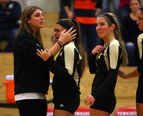Tewksbury: Bishop Fenwick assistant coach Lauran DiCarlo, left, consoles tearful senior Chandler Wilder, center, as senior captain Jen Crovo, right, looks up at the scoreboard after the Crusaders were eliminated 3-0 by Notre Dame Academy in the D2 State Semifinal. David Le/Salem News
