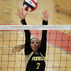 Tewksbury: Bishop Fenwick senior captain Jen Crovo leaps high in the air on a block attempt. David Le/Salem News