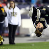 Foxborough: Bishop Fenwick senior Alexis Salvaggio performs a flip during the D5 State Championship on Saturday evening at Gillette Stadium. DAVID LE/Staff Photo 12/7/13